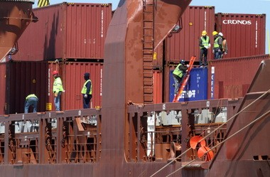 Longshoremen were busy Saturday unloading the Fortunagracht, which carried cargo from Europe in shipping containers.