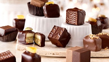 Consumers with too much bitcoin in their virtual wallets will be able to spend it at Mitchell's Fine Chocolates and other Cleveland Heights retailers and merchants starting May 1.