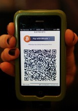 Bitcoin users must scan the QR code of the merchant they're purchasing from to send them payment in bitcoin.