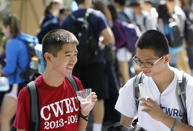 Cleveland's workforce is growing younger and smarter, thanks in part to talent from abroad. Engineering students Zheng Lin Huang, left, and Tianlong Chen met other students at a mixer at Case Western Reserve University last fall.