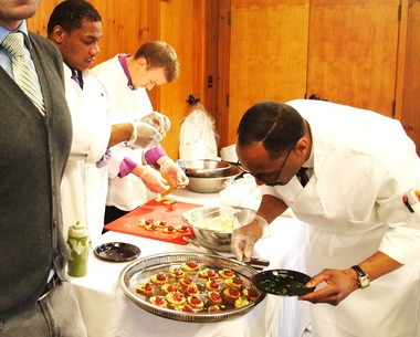 Chefs from EDWINS restaurant labor over their beef tartar with arugula at a fundraiser at the Shaker Lakes Nature Center. EDWINS, which trains ex-offenders as chefs and servers, is the kind of business SEA Change hopes to help.