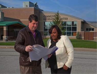Seven Hills city service director Stewart Lovece and Emerald Cities Cleveland director Shanelle Smith check planning documents for $1.9 million energy efficiency upgrades of municipal buildings.