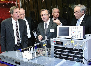 Gov. John Kasich tours UA's Polymer Innovation Center with Luis Proenza, right, in 2011. Proenza is being honored by Team NEO for promoting economic development with university research.