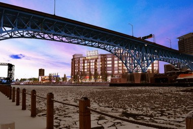 A rendering shows the 243-unit apartment building at the Flats East Bank project in downtown Cleveland. A seasonal nightclub would occupy a site north of the apartments, near the Cuyahoga River's edge.