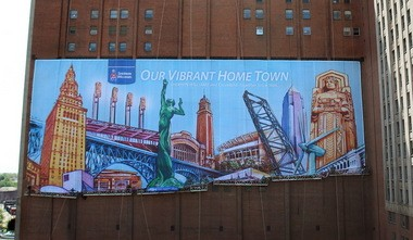 Sherwin-Williams Co. unveiled its current 10-story banner in May 2013. The image, rendered by a local artist, is a colorful salute to Cleveland celebrating many of the city's most recognizable landmarks.
