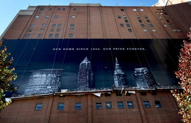Workers installed the first Sherwin-Williams Co. banner on the Landmark Office Towers in October 2010. The image replaced an iconic photograph of LeBron James, who left Cleveland for Florida earlier that year.