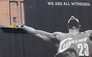 Workers began disassembling downtown Cleveland's 10-story mural of LeBron James on July 10, 2010.