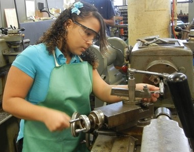 Max Hayes students work in the machine shop at their school. The school has a relationship with the manufacturing industry in part through Wire-Net, which stands for Westside Industrial Retention & Expansion Network.