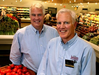 Tom Heinen, left, and his twin brother Jeff Heinen, are in Chicago introducing themselves to shoppers at their newest store in the Village of Lake Bluff, Illinois.