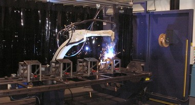 At Astro Manufacturing & Design's sheet metal fabricating division in Willoughby, the custom manufacturer purchased a two-station robotic Mig welder for a large ongoing production order of about 1,000 steel components.