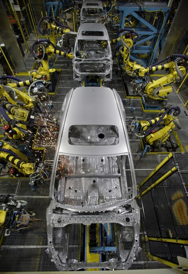 Honda uses robots throughout the manufacturing process. Here robots perform welding tasks on a CR-V at the East Liberty, Ohio plant