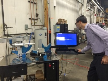 """Steve Somes, president of Force Robots in Cleveland, said he's encouraged about possibilities for a new robot that he developed as an incubator tenant at Magnet, a manufacturing advocacy organization. The """"Touch robot,"""" he created works by force to perform finishing operations like grinding and polishing."""
