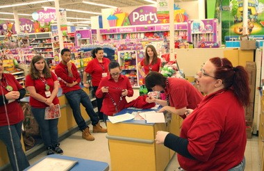 Toys 'R' Us employees are briefed with last minute instructions before the doors open at 5 p.m. on Thanksgiving.