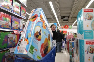 Katie Zeman of Mentor pushes a loaded cart through the aisles of Toys 'R' Us in Mentor in this 2013 photo.