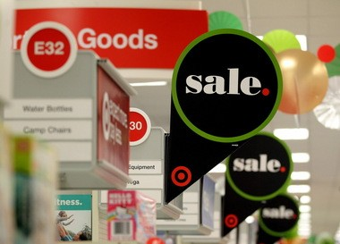 Sale signs hang from the aisles at the Target Store in North Olmsted on Black Friday 2013.