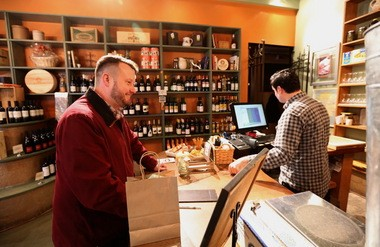Jason Bristol buys a $100 gift certificate at Market at the Fig in Ohio City on Wednesday.
