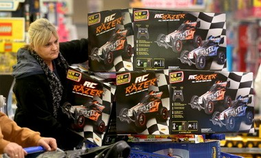 A Black Friday shopper considers a display of remote controlled cars at Toys 'R' Us in Parma.