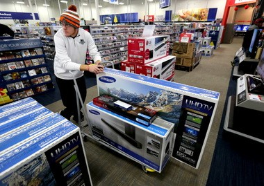 Kevin Weir waits to purchase his electronics inside the Best Buy store in Strongsville on Black Friday