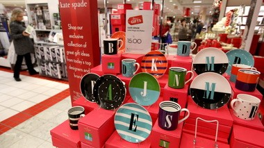 A display of monogrammed mugs and plates awaits buyers inside Macy's at SouthPark Mall in Strongsville on Black Friday.
