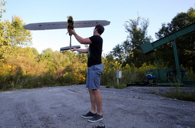 Jeff Taylor readies one of his drones for a flight over a farm outside of Ravenna in September.
