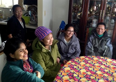 Gori Maya Acharya, second from right, and her co-workers at National Safety Apparel make up one of several lending circles in the Bhutanese immigrant community.