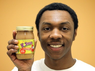 Ethan Holmes, 21, makes and bottles his own all-natural, no-sugar-added Holmes Mouthwatering Applesauce based on his grandfather's recipe. His goal is to make healthier foods accessible to everyone who wants them, and is donating 10 percent of the profits from each jar to efforts to fight childhood obesity.