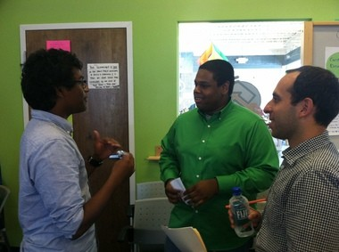 Bharath Katragadda, who participated in the LEAP summer program in 2013 and worked with the program in 2014, acts out a scenario on negotiation with LaunchHouse intern, Isaiah Williams, as LaunchHouse CEO Todd Goldstein watches. From left to right: Katragadda, Williams and Todd Goldstein