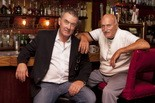 Nighttown owner Brendan Ring, left, seated with original owner John Barr, said Lee Hawkins' panoramas have increased Nighttown's bookings by private parties.