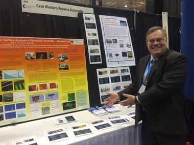 Chris Duston, executive director for the Institute for Advanced Materials at Case Western Reserve University, shows off the university's capabilities at the Ceramics Expo at the IX Center last week. Area manufacturers pay fees to the university for access to certain machines and research.