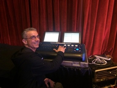 Hughie's Event Production Services Technician Abbas Zand runs an HES (High-End Systems) IPC lighting control console at a charity gala event. Hughie's employees say the managers treat everyone like family.