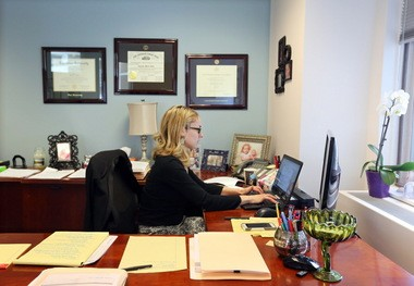 Attorney Amanda Gatti works at her desk at Reminger Co., LPA on May 14, 2015. Reminger Co., LPA law firm bumped out Tucker Ellis as the top workplace among mid-sized companies.