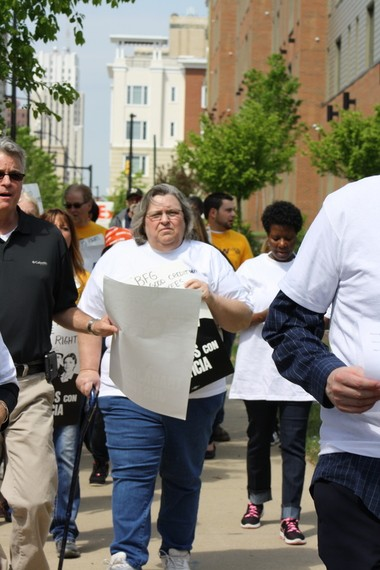 Mary Labbe, (center) a laid-off BFG Federal Credit Union worker, at a rally OPEIU 1794 held in May, saying the credit union had laid off workers who organized a union.