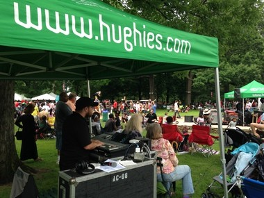 Employees from Hughie's Event Production Services manage the audio for musicians at Parade the Circle on June 13, 2015.