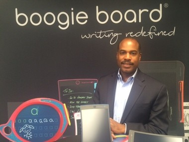 Albert Green, CEO of Kent Displays, makers of the Boogie Board line of e-writer products, poses with the product.