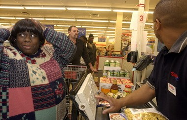 A shopper moves through the checkout in this Plain Dealer file photo. Cuyahoga County Weights and Measures inspectors found 20 percent of the 36 stores it checked charging incorrect prices.