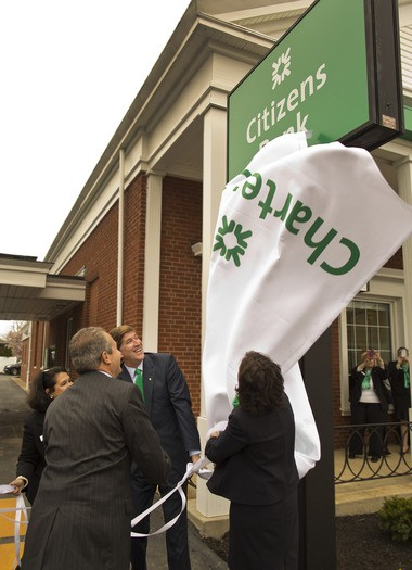 Bruce Van Saun, center, CEO of Citizens Bank, helps unveil the sign and new name at a Lakewood branch in April. Charter One changed its name in Ohio and Michigan to Citizens 11 years after it sold to Citizens.