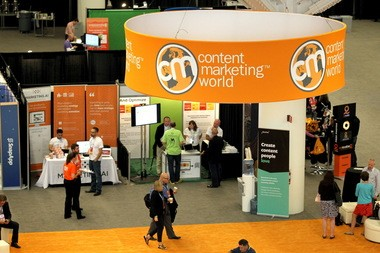 "The orange carpet underneath the spinning ""Content Marketing World"" sign is a favorite place for in-real-life meet-ups at CMWorld at the Cleveland Convention Center."