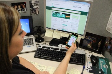 """Medical Mutual's Laura Dunn enters a purchase into Mutual Appreciation's website. Four years ago the insurance company started a """"Mutual Appreciation"""" program that encourages and rewards its 2,400 Ohio employees with cash rewards when they buy goods and services from local businesses that are Medical Mutual customers."""