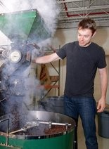 Matthew Dellavedova helps roast coffee beans for Cleveland Coffee Co.'s G'Day Mate Coffee.