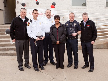 From left, Dave Taiclet, president of Gourmet Food Brands for 1-800-Flowers.com, Maple Heights Fire Captain Dan Sypen, Maple Heights Fire Chief Vito Kavaliunas, Mayor Annette Blackwell, Maple Heights Police Captain Todd Hansen, and Fannie May Brands President Kevin Coen.