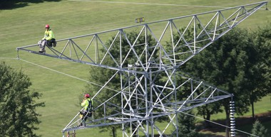 The price of power flowing over high-voltage lines like this FirstEnergy transmission line is the lowest in years. New, lower customer rates, which the PUCO approved this week, will lower monthly bills starting in June.