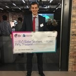 RVS Rubber Solutions co-founder Pavel Galchenko holds his team's $50,000 Cleantech University Prize.