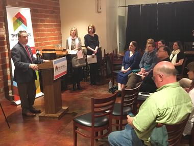 Cleveland Councilman Matt Zone, Jenny Spencer, managing director of Detroit Shoreway Development Organization and Elizabeth Newman, president and CEO of The Centers for Families and Children announce the Hire Local partnership Tuesday at the Astoria Cafe & Market.