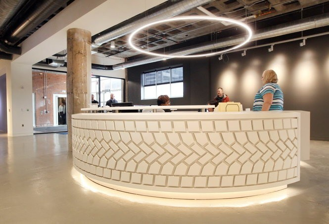 The new front lobby area of Dealer Tire, in the midtown area of Cleveland, with a front desk designed as a tire tread.