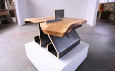 A pair of custom side tables with steel bases and soft maple slab tops.