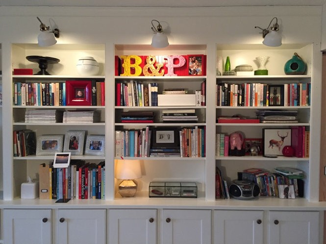 Wall of shelves created by maker Tim Roos of Rooswork. The custom shelves and casework, in a home in Shaker Heights, are his favorite piece of work.