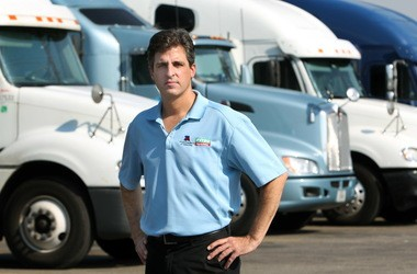 Thomas O' Brien, chief executive officer and president of TravelCenters of America, stands in front of a row of trucks parked at the company's Lodi center in 2011.