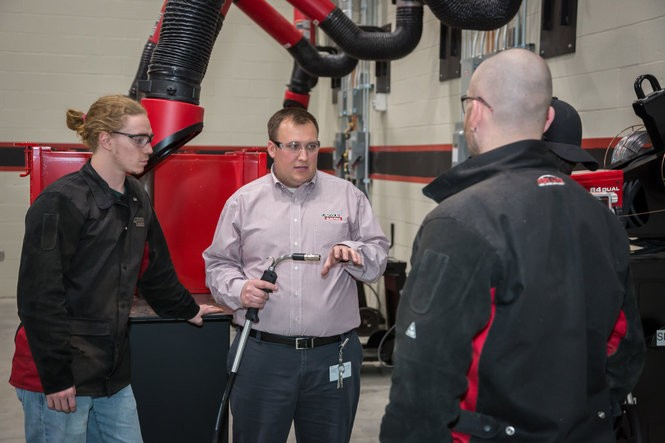 Sales Training Manager Alex Monico instructs students Wednesday at Lincoln Electric's new $30 million Welding Technology & Training Center.