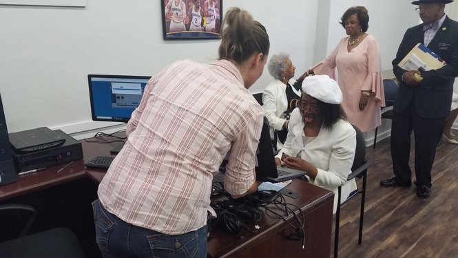 A few members of The Elizabeth Baptist Church, across the street from the temporary location of PCs for People, were among the first people invited to check out the storefront on Sunday in Slavic Village. This senior citizen, seated, qualified to take a computer home with her.