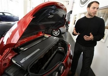 Joe Powers, northeast region sales manager with Tesla Motors, explains how the battery pack operates and powers the Tesla Roadster electric car.